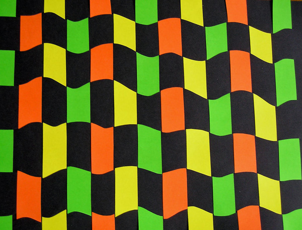 Плетеный бумажный коврик